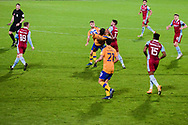 Jason Law (29) of Mansfield Town Alistair Smith (30) of Mansfield Town Andy Dales (17) of Scunthorpe United battles for possession during the EFL Trophy match between Scunthorpe United and Mansfield Town at the Sands Venue Stadium, Scunthorpe, England on 10 November 2020.