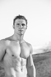 shirtless muscular man outdoors