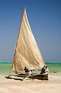 A traditional wooden sailing dhow on Kiwendwa Beach, Zanzibar, Tanzania