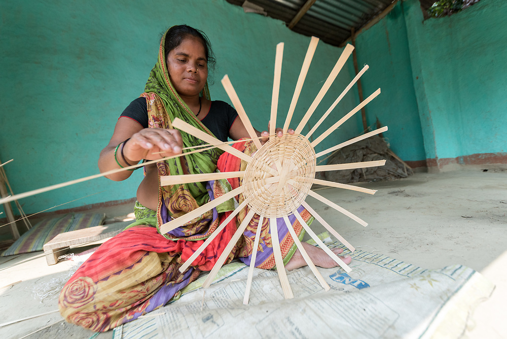 16 September 2018, Sohal Tole, Jahada rural municipality, Nepal: Parda Mohali is a basket maker in the Sohal Tole community. Basket making is a traditional skill among the Mohali (Tarai Dalits, meaning Dalits living on the plainlands of eastern Nepal), but it is only recently that they have been able to access the market and start selling their goods, in the nearby town of Biratnagar, Province 1, Nepal. Access has been made possible through support from the Nepal Evangelical Lutheran Church. Sohal Tole is a community inhabited by Santal and Dalit (Musahar) people, who find themselves as the very margin of society in Nepal. The 54 households are supported by the Nepal Evangelical Lutheran Church, as they mobilize together on disaster preparedness, income generating activities, financial governance, and mobilization on sanitation, education and entrepreneurship. The community project also receives technical support from the Lutheran World Federation World Service programme.
