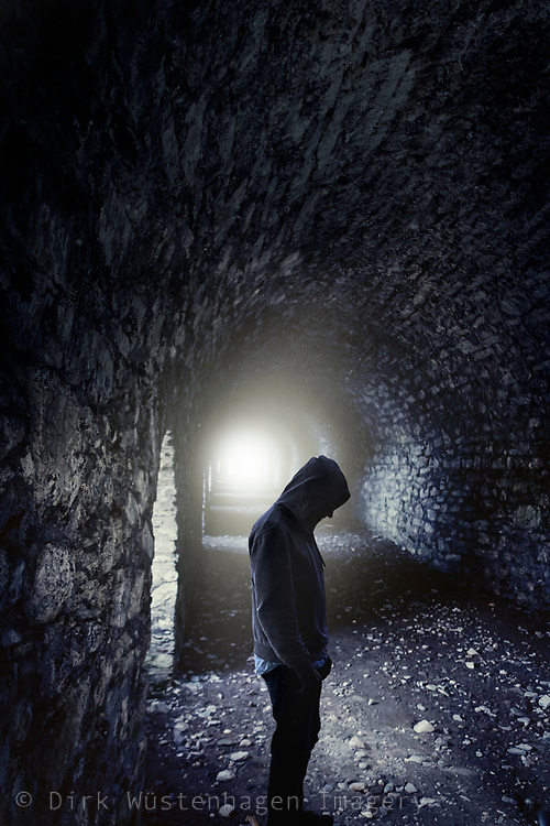 Man standing in a tunel