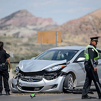 051614       Cable Hoover<br /> <br /> Gallup Police and New Mexico State Police investigate the site of a vehicle and motorcycle crash on Historic Highway 66 in Gallup Friday.
