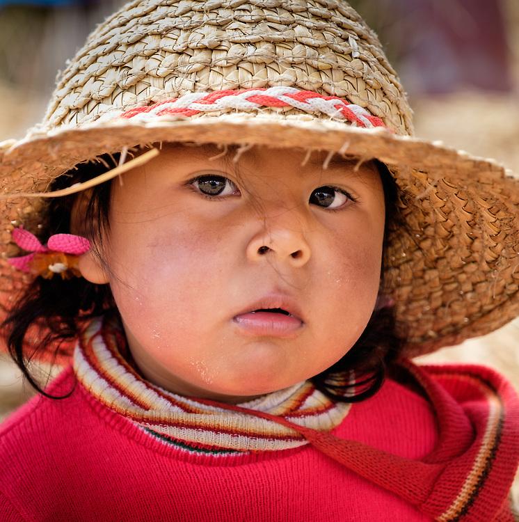 UROS ISLANDS, PERU - CIRCA October 2015: Girl from the Uros Islands in Lake Titicaca.