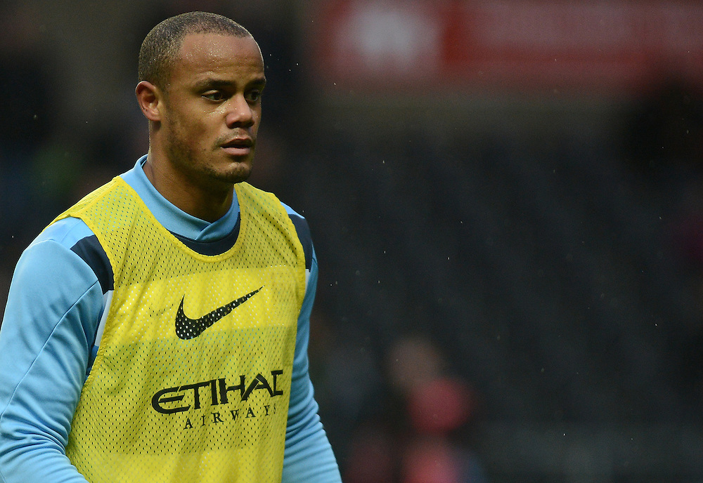 Manchester City's Vincent Kompany during the pre-match warm-up <br /> <br /> Photo by Ian Cook/CameraSport<br /> <br /> Football - Barclays Premiership - Swansea City v Manchester City - Wednesday 1st January 2014 - Liberty Stadium - Swansea<br /> <br /> © CameraSport - 43 Linden Ave. Countesthorpe. Leicester. England. LE8 5PG - Tel: +44 (0) 116 277 4147 - admin@camerasport.com - www.camerasport.com