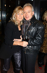 LIZ BREWER and actor NIKOLAS GRACE at a pre-screening party of a film by Fiona Sanderson entitled 'The Hunt For Lord Lucan' held at Langans, 254 Old Brompton Road, London SW7 on 8th November 2004.<br />