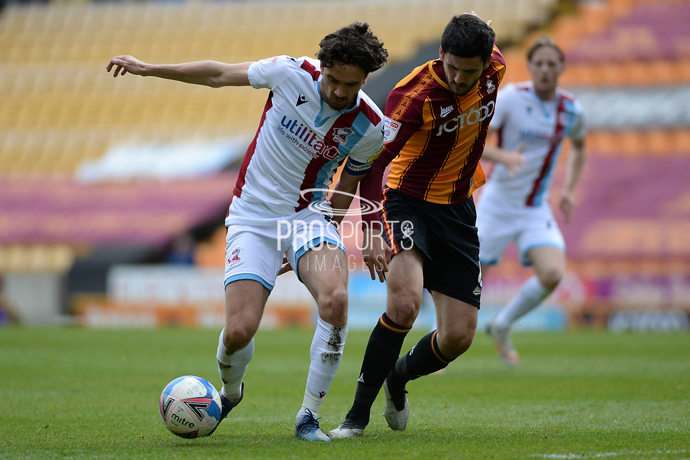 Scunthorpe United Alex Gilliead (8) Bradford City Anthony O'Connor (6) battles for possession during the EFL Sky Bet League 2 match between Bradford City and Scunthorpe United at the Utilita Energy Stadium, Bradford, England on 1 May 2021.