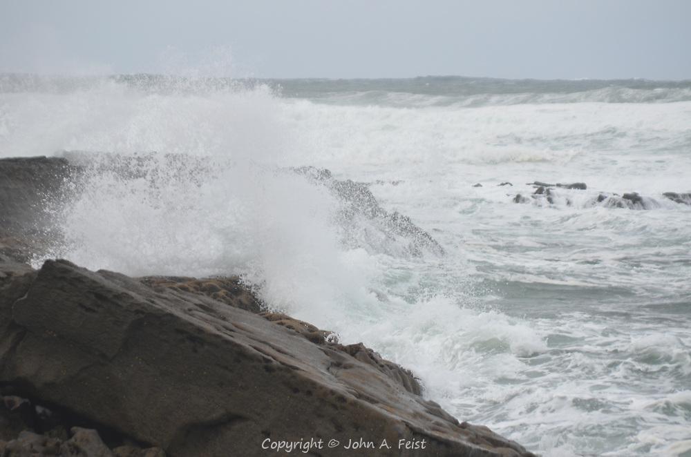 Waves crashing into the rocky shore at Doolin, County Clare, Ireland.