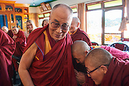 Two Geshemas are paying respect to His Holiness Dalai Lama at the end of the lunch with him after the first Geshema convocation at Drepung Lachi in Mundgod, Karnataka, India on December 22, 2016.