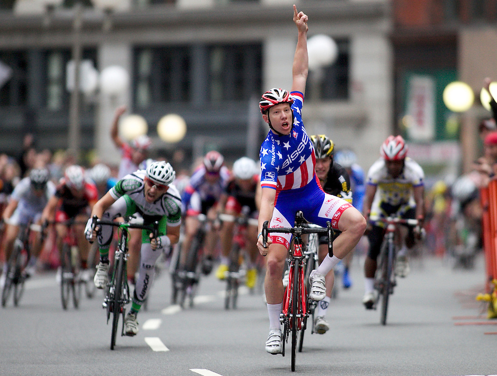 (092610  Boston, Mass.)  Bissell Pro Cycling's Daniel Holloway, wearing stars and stripes as the criterium men's national champion, celebrates his victory as he crosses the finish line for the 2010 Mayor's Cup Men's Pro division criterium race on Sept. 26, 2010. Herald Photo by KELVIN MA. Saved in Monday