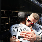 NEW YORK, NEW YORK - June 01: Brett Lawrie #15 of the Chicago White Sox embrace the batboy in the dugout before the Chicago White Sox  Vs New York Mets regular season MLB game at Citi Field on June 01, 2016 in New York City. (Photo by Tim Clayton/Corbis via Getty Images)