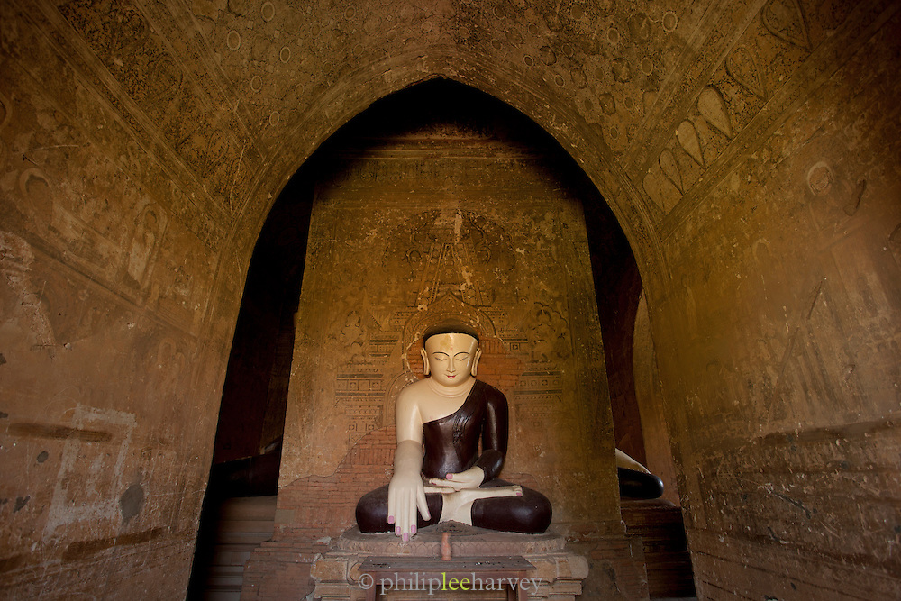 A buddha statue inside a temple, one of the hundreds in the ancient city of Bagan, Myanmar