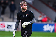 Lee Burge of Coventry City (1) warming up during the EFL Sky Bet League 1 match between Scunthorpe United and Coventry City at Glanford Park, Scunthorpe, England on 5 January 2019.