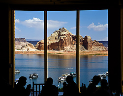 Lake Powell, Arizona:  Diners inside the Rainbow Room dining area of Lake Powell Resort seem indifferent to the magnificent natural spectacle outside the dining room window.