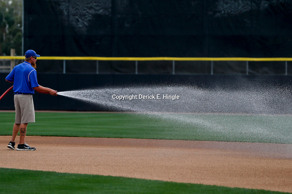 Feb 24, 2013; Dunedin, FL, USA; A grounds keeper prepares the field before a spring training game between the Toronto Blue Jays and the Baltimore Orioles at Florida Auto Exchange Park. Mandatory Credit: Derick E. Hingle-USA TODAY Sports