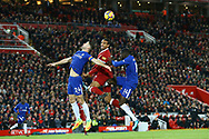 Joel Matip of Liverpool jumps for the ball between Gary Cahill (l) and Tiemoue Bakayoko of Chelsea. Premier League match, Liverpool v Chelsea at the Anfield stadium in Liverpool, Merseyside on Saturday 25th November 2017.<br /> pic by Chris Stading, Andrew Orchard sports photography.