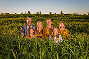 Before heading to Tanzania, the Boos family poses in a field of sudan grass at their farm near Elkhart Lake, Wisconsin. (Photo © Andy Manis)