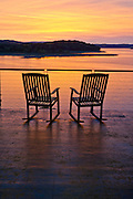 Rocking chairs at sunrise at a home on Beaver Lake in Rogers Arkansas