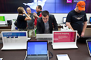 Oct. 22, 2009 -- SCOTTSDALE, AZ:  Customers look at laptop computers running Windows in the new Microsoft store in Scottsdale, AZ, Thursday. Microsoft's first retail store opened in Fashion Square Mall in Scottsdale, AZ, Thursday. Microsoft's first foray into retail is widely considered to be a shot across the bow of Apple computers. The store's design is similar to Apple stores and the new Microsoft store is between two Apple stores, one in an upscale shopping mall five miles north of the Microsoft store, the other  in an upscale shopping area about 5 miles west of the Microsoft store. Microsoft used the occasion to officially launch the newest version of Windows 7, the newest version of Windows, Microsoft's flagship product.    Photo by Jack Kurtz