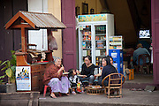 Families eat at a small street restaurant in Luang Prabang, Laos.