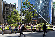 City workers enjoy still warm lunchtime temperatures in Leadenhall in the City of London, (aka The Square Mile) the capital's financial district, on 3rd September 2019, in London, England.