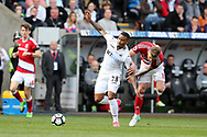 Luciano Narsingh of Swansea city breaks away from Adam Clayton of Middlesbrough (r)  .Premier league match, Swansea city v Middlesbrough at the Liberty Stadium in Swansea, South Wales on Sunday 2nd April 2017.<br /> pic by Andrew Orchard, Andrew Orchard sports photography.