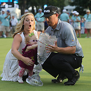 Hunter Mahan, winner of The Barclays manages to catch the trophy as his daughter Zoe pushes it over much to the dismay of wife Kandi after the fourth round of theThe Barclays Golf Tournament at The Ridgewood Country Club, Paramus, New Jersey, USA. 24th August 2014. Photo Tim Clayton