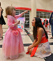 Madysen Khamphengphet, a sophomore at Ravenwood portraying Moana, talks with Eleanor Brown during the Ravenwood Royal Experience at Ravenwood High School Saturday, March 30, 2019. During the event children met Disney Princesses and enjoyed a sing along with them. The event is a fundraiser for St Jude Children's Hospital and the Ravenwood Theatre Department. Photo Harrison McClary/News & Observer
