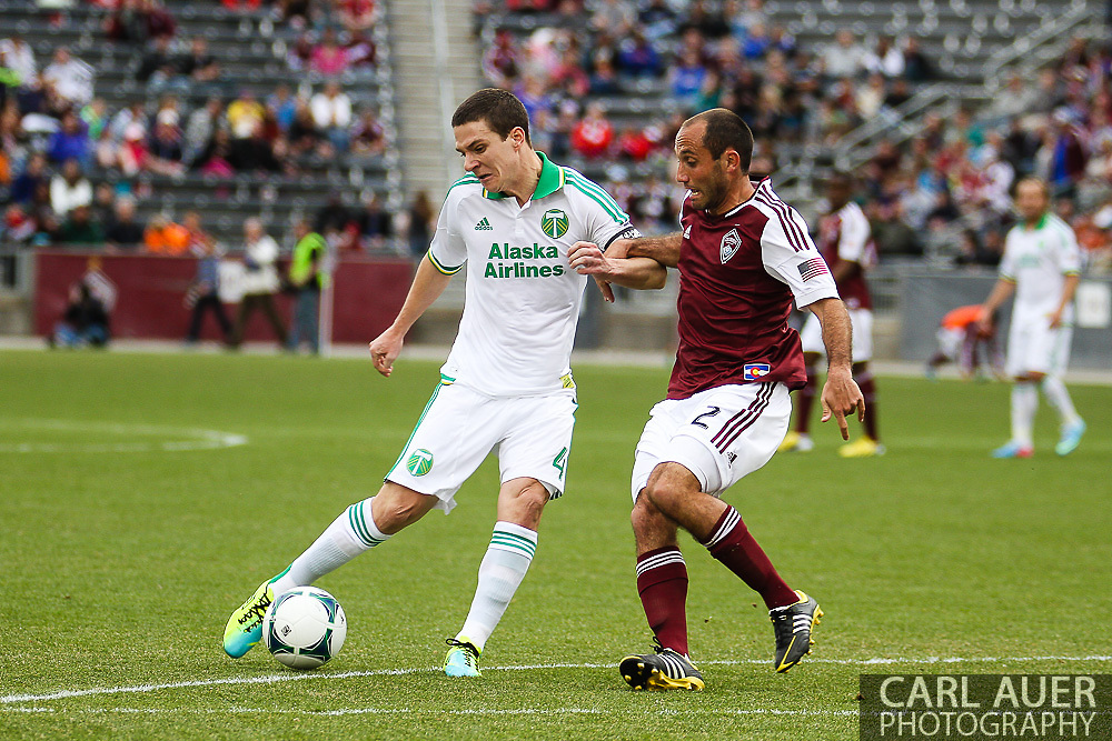 March 30th, 2013 Commerce City, CO - Portland Timbers midfielder Will Johnson (4) turns for a shot attempt past Colorado Rapids midfielder Nick LaBrocca (2) in the first half of the MLS match between the Portland Timbers and the Colorado Rapids at Dick's Sporting Goods Park in Commerce City, CO