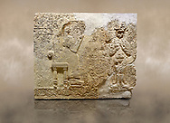 """Photo of Hittite relief sculpted orthostat stone panel  of Long Wall Limestone, Karkamıs, (Kargamıs), Carchemish (Karkemish), 900-700 BC. Anatolian Civilisations Museum.<br /> <br />  The hieroglyphics reads; """"I am Win-a-tis, beloved wife of my Lord Suhi, wherever and whenever my husband honours his name, he will honour my name as well with favours"""". Underneath, there are two goddess figures, one is naked with a horned head, holding her breasts with her hands. Her genitalia is indicated by a triangle. <br /> <br /> On a brown art background. .<br />  <br /> If you prefer to buy from our ALAMY STOCK LIBRARY page at https://www.alamy.com/portfolio/paul-williams-funkystock/hittite-art-antiquities.html  - Type  Karkamıs in LOWER SEARCH WITHIN GALLERY box. Refine search by adding background colour, place, museum etc..<br /> <br /> Visit our HITTITE PHOTO COLLECTIONS for more photos to download or buy as wall art prints https://funkystock.photoshelter.com/gallery-collection/The-Hittites-Art-Artefacts-Antiquities-Historic-Sites-Pictures-Images-of/C0000NUBSMhSc3Oo"""