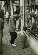 C012-25_Tom Hutchins_Mother and son in front of shop. Wang Fu Chin, Peking, China 1956 vintage A2 spotted.tif