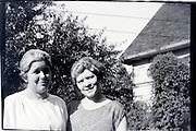 sister posing in garden setting 1920s USA