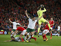October 9, 2017 - Cardiff, Pays de Galles - Wayne Hennessey of Wales collects as Ciaran Clarke of Ireland claims a penalty (Credit Image: © Panoramic via ZUMA Press)