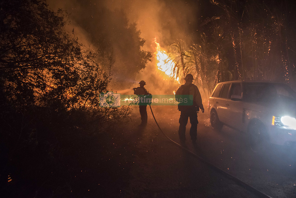 July 6, 2018 - Goleta, California, U.S - Firefighters fight the HOLIDAY FIRE as residents evacuate the area north of Fairview Avenue Friday evening. (Credit Image: © Erick Madrid via ZUMA Wire)