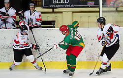 Mathias Grabner of Austria vs Andrejus Zidkovas of Lithuania  during the ice hockey match between National teams of Lithuania (LTU) and Austria (AUT) at 2011 IIHF World U20 Championship Division I - Group B, on December 12, 2010 in Ice skating Arena, Bled, Slovenia.  (Photo By Vid Ponikvar / Sportida.com)