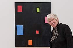 "© Licensed to London News Pictures. 07/06/2016. London, UK.   The American artist Mary Heilmann, stands in front of ""Twinkle Detail"" ahead of her first major UK exhibition, ""Looking at Pictures"", at the Whitechapel Gallery.  The exhibition spans the artist's five decade career, from her early geometric paintings made in the 1970s to her recent shaped canvases in day-glo colours.  The show features approximately 45 paintings as well as a selection of ceramics, chairs and works on paper, many of which have never been exhibited.  Photo credit : Stephen Chung/LNP"