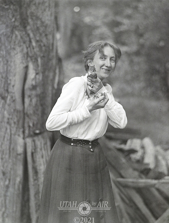 Martha with squirrel early 1900's