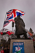 Pro Brexit Leave supporters gather at the statue of Churchill in Westminster on Brexit Day as the UK prepares to leave the European Union on 31st January 2020 in London, England, United Kingdom. At 11pm on Friday 31st January 2020, The UK and N. Ireland will officially leave the EU and go into a state of negotiations as to the future arrangement and trade agreement, while adhering to EU rules until the end of 2020.