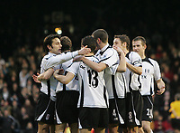 Photo: Lee Earle.<br /> Fulham v Stoke City. The FA Cup. 27/01/2007.Fulham players congratulate Tomasz Radzinski (13) after he scored their third goal.