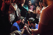 Nader (left) puts a ring on Omar's (right) finger after he accepted Nader's marriage proposal during Omar's birthday party in Istanbul, Turkey