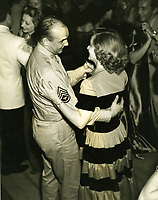 August 29, 1942 Bette Davis dancing with Sgt. Jackie Coogan at the premiere party for The Talk Of The Town held at Ciro's Nightclub