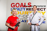 Environmental portrait of Jenny and Adam O'Connor with the American Taekwando Association at their school in Bentonville, Arkansas.