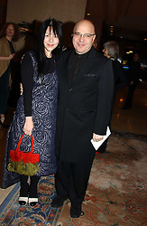 Film director ANTHONY MINGHELLA and his wife CAROLYN at the Conde Nast Traveller magazine Tsunami Appeal Dinner at the Four Seasons Hotel, Hamilton Place, London W1 on 2nd March 2005.<br /><br />NON EXCLUSIVE - WORLD RIGHTS