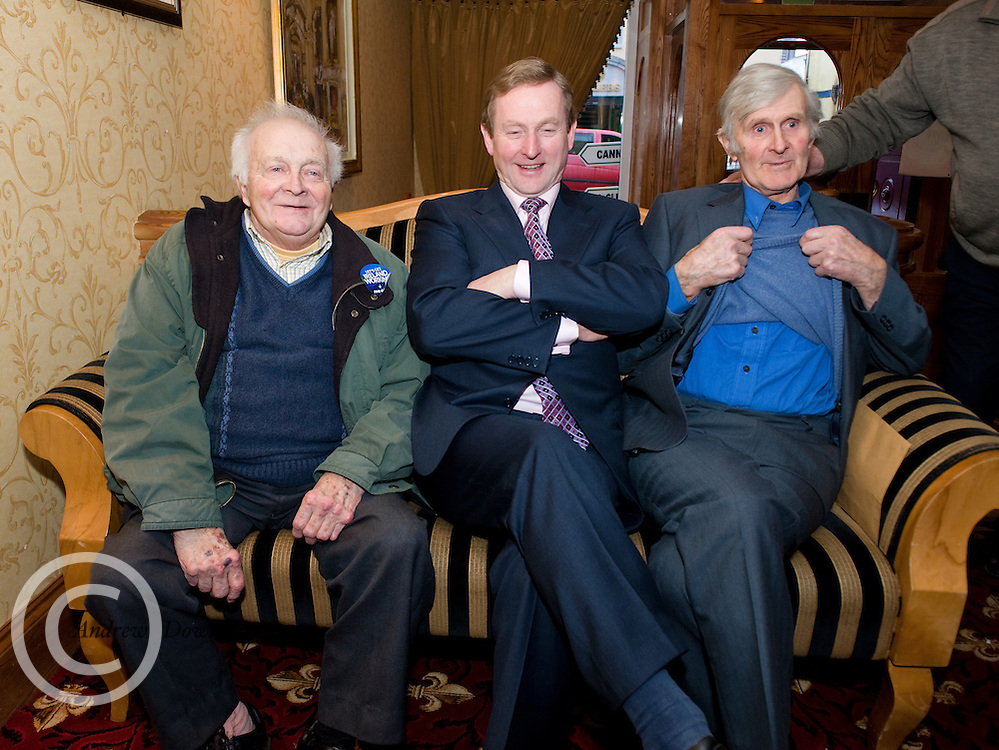 Leo Tierney (right), Kiltormer, shows off his true colours to Fine Gael leader Enda Kenny and Liam Naughton, Ahascaragh, in Ballinasloe,