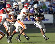 Kansas State running back James Johnson (8)rushes up field against pressure from Iowa State defenders at Bill Snyder Family Stadium in Manhattan, Kansas, October 28, 2006.  The Wildcats beat the Cyclones 31-10.<br />