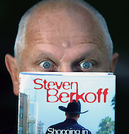 Steven Berkoff shows off a copy of his latest book Shopping in ther Santa Monica Mall: Journals of a Strolling Player at the Edinburgh International Book Festival where he gave a talk about his work......