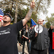Members of the National Socialist Movement, a Neo Nazi group, led by Southwestern Regional Director Jeff Russell Hall, with megaphone,rallies in Claremont, California against illegal immigration. Please contact Todd Bigelow directly with your licensing requests.