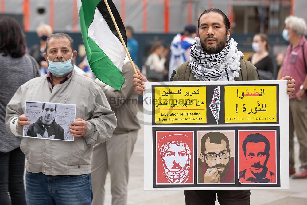 "Köln, Germany - 04.07.2020<br /> <br /> ""Stop the land grab - Stop the annexation"" rally of the Palestinian community of Cologne in front of Cologne Cathedral. On signs and with the shouted slogan (""from the river to the sea"") Israel was denied the right to exist. On the fringes of the rally, ""Pro Israel"" protesters gathered for counterprotests.<br /> <br /> ""Stoppt den Landraub - Stoppt die Annexion""-Kundgebung der palästinensischen Gemeinde Köln vor dem Kölner Dom. Auf Schildern und mit der skandierten Parole (""from the river to the sea"") wurde Israel das Existenzrecht abgesprochen. Am Rande der Kundgebung versammelten ""Pro Israel""-Demonstranten zu Gegenprotesten.<br /> <br /> Photo: Björn Kietzmann"