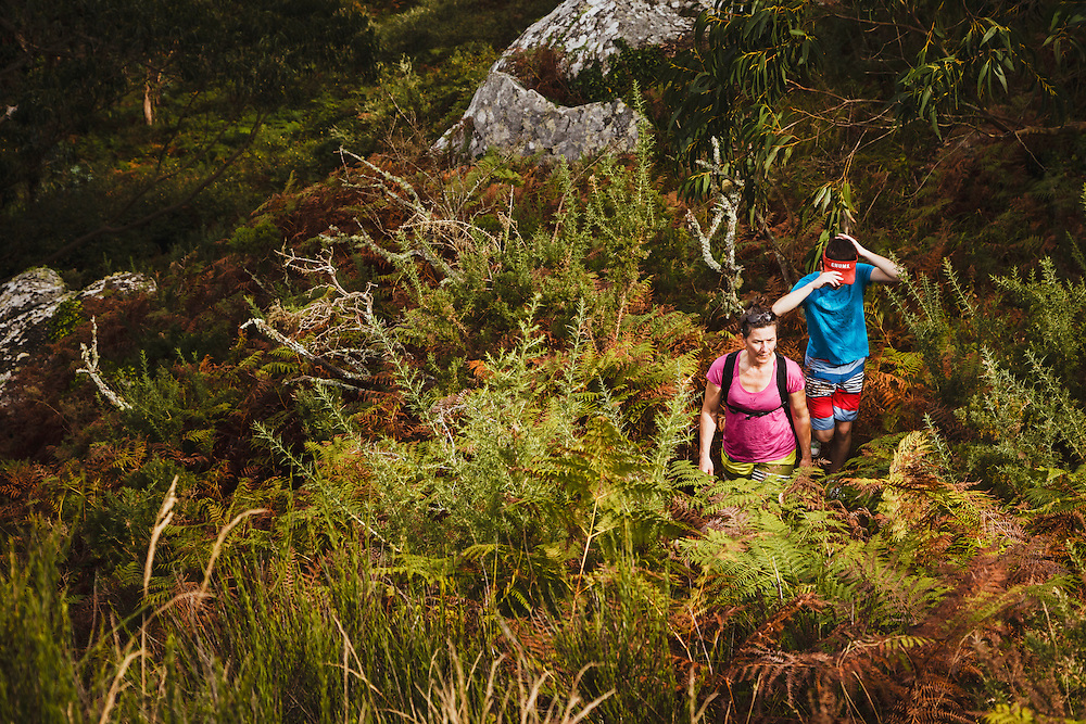 A family explore the San Martino Island, part of the Cies Islands of Spain.