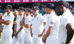 © Licensed to London News Pictures. 05/01/2014. Alastair Cook and a disappointed England team at the end of the Ashes  during day 3 of the 5th Ashes Test Match between Australia Vs England at the SCG on 5 January, 2013 in Melbourne, Australia. Photo credit : Asanka Brendon Ratnayake/LNP