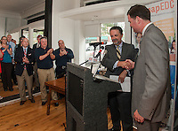 Mayor Ed Engler and BEDC Vice Chair Randy Eifert shake hands during the press conference held at Wayfarer Coffee Roasters announcing the purchase of the Colonial Theater in downtown Laconia.  (Karen Bobotas/for the Laconia Daily Sun)